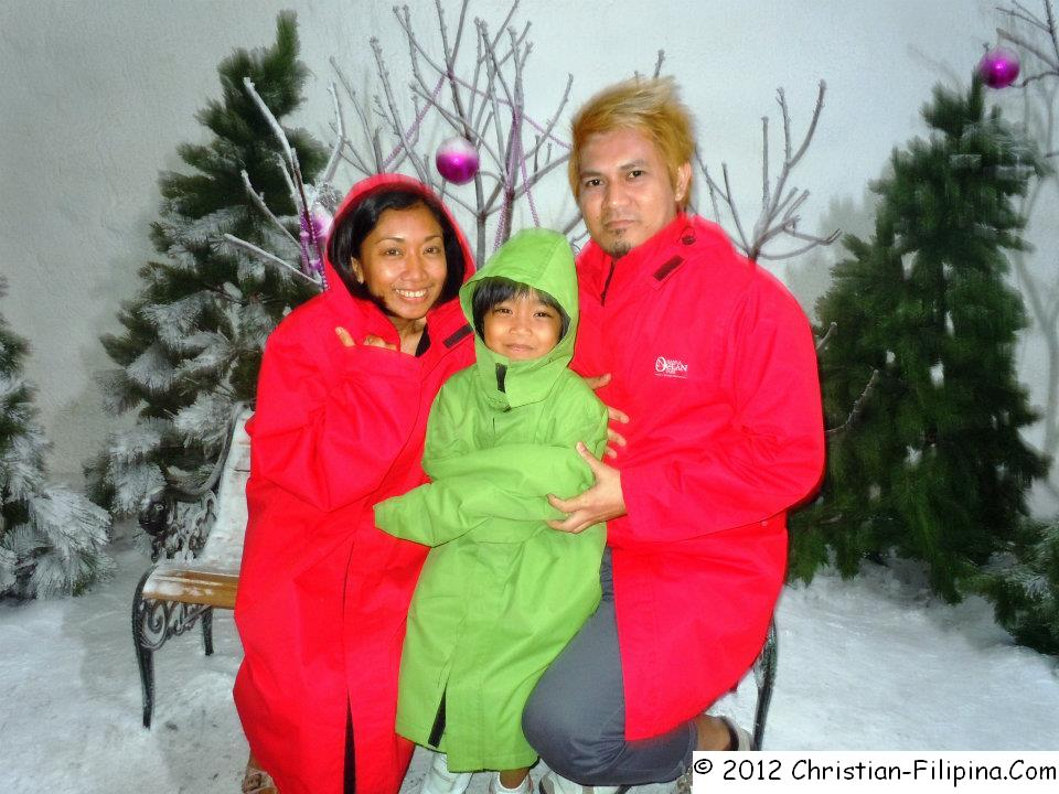 A Filipino family celebrating Christmas in Star City, Philippines